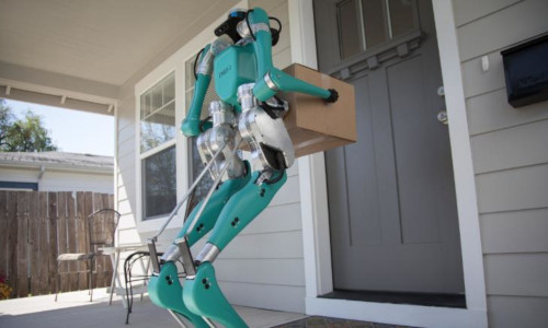 A robot with a box in front of a door